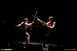"Cyril (Jeremy Adams) duels a Nihilist assassin (Tom Stewart) at the climax of ""Fatal Footlights."""